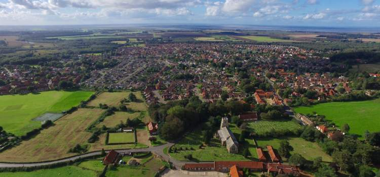 slideshow image of an aerial view of dersingham village
