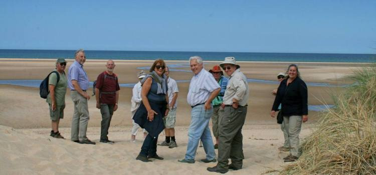 walking group on the beach