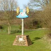 image of dersingham village sign